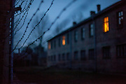 A barbed wire fence surrounds the Auschwitz Nazi concentration camp. It is estimated that between 1.1 and 1.5 million Jews, Poles, Roma and others were killed in Auschwitz during the Holocaust in between 1940-1945.