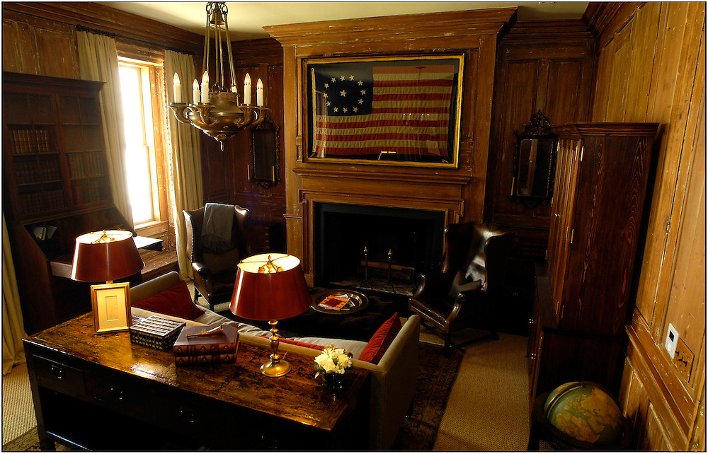 John Dewberry stripped 200 year's of old paint off the cedar-paneled walls to expose the natural wood grain and 18th century craftsmanship of the second floor den. (Stephen Morton for The New York Times).....