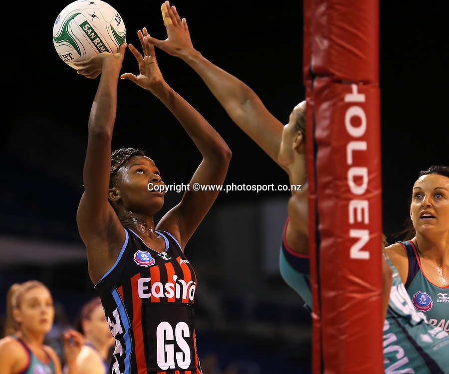 Mwai Kumwenda of the Tactix takes a shot at goal with Geva Mentor of the Vixens in defence during the ANZ Championship Netball between Mainland Tactix v Melbourne Vixens, held at CBS Arena, Christchurch. 31 March 2014 Photo: Joseph Johnson/www.photosport.co.nz