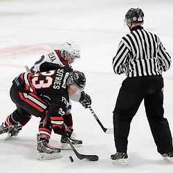 "FORT FRANCES, ON - Apr 28, 2015 : Central Canadian Junior ""A"" Championship, game action between the Soo Thunderbirds and the Dryden GM Ice Dogs, game one of the Dudley Hewitt Cup, Cole Golka #22 of the Dryden GM Ice Dogs and Brett Jefferies #23 of the Soo Thunderbirds during a face-off<br /> (Photo by Amy Deroche/ OJHL Images)"