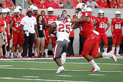 NORMAL, IL - September 01: Tuvone Clark gets the stiff arm by Jamarri Watson but ends up with the tackle during a college football game between the ISU (Illinois State University) Redbirds and the Saint Xavier Cougars on September 01 2018 at Hancock Stadium in Normal, IL. (Photo by Alan Look)