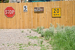 Signs on a wooden fence in New Mexico