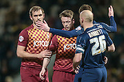 Nathan Clarke (Bradford City) is marked closely at the corner during the Sky Bet League 1 match between Bradford City and Southend United at the Coral Windows Stadium, Bradford, England on 16 February 2016. Photo by Mark P Doherty.