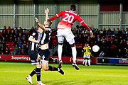 Salford City forward Mani Dieseruvwe fouls Grimsby Town defender Luke Waterfall during the EFL Sky Bet League 2 match between Salford City and Grimsby Town FC at Moor Lane, Salford, United Kingdom on 17 September 2019.