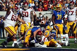 BERKELEY, CA - SEPTEMBER 23:  Running back Stephen Carr #7 of the USC Trojans scores a touchdown against the California Golden Bears during the fourth quarter at California Memorial Stadium on September 23, 2017 in Berkeley, California. The USC Trojans defeated the California Golden Bears 30-20. (Photo by Jason O. Watson/Getty Images) *** Local Caption *** Stephen Carr