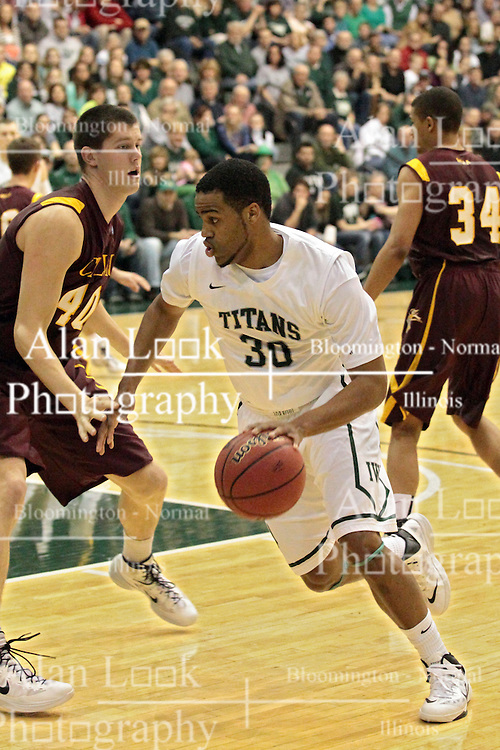 14 March 2014:  Michael Welch & Eric Dortch during an NCAA mens division 3 quarter final basketball game between the Calvin Knights and the Illinois Wesleyan Titans in Shirk Center, Bloomington IL
