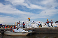 Clean-up workers hired by BP private contractors at the  Myrtle Grove Marina in Port Sulphur Louisiana  where supplies for crews headed out into  Barataria Bay are staged.