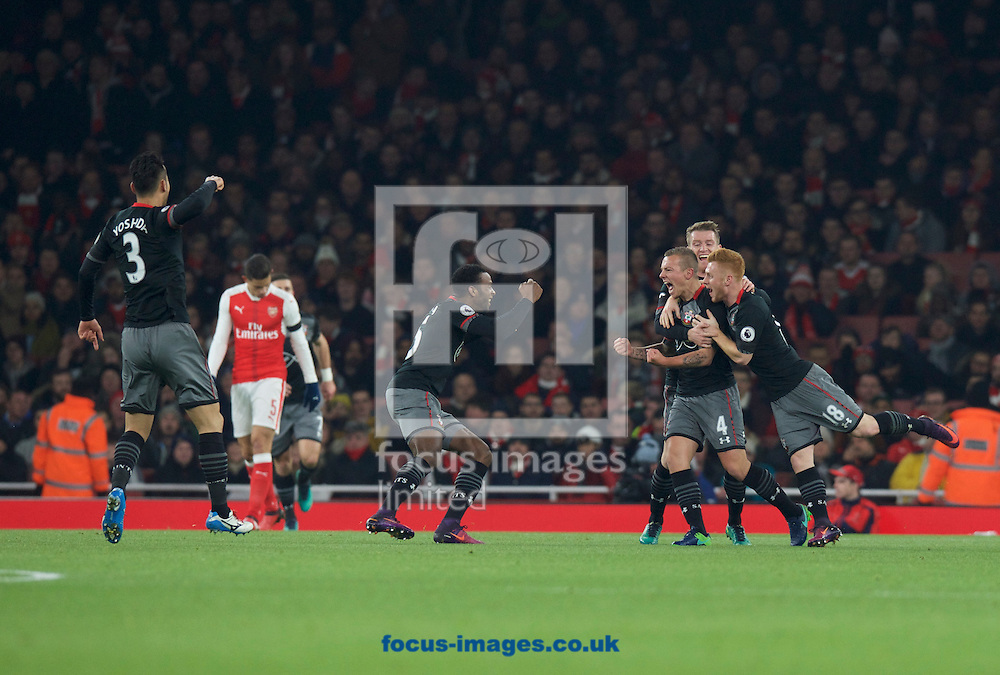 Jordy Clasie of Southampton celebrates with Harrison Reed (18) after scoring the opening goal during the EFL Cup match at the Emirates Stadium, London<br /> Picture by Alan Stanford/Focus Images Ltd +44 7915 056117<br /> 30/11/2016