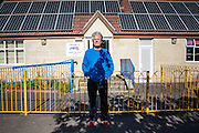 Peter Andrews of Bath and West Community Energy in the playground of Oldfield Park Infant School where a Solar PV array was fitted to the roof as a community project set up by BWCE. Bath, Somerset.