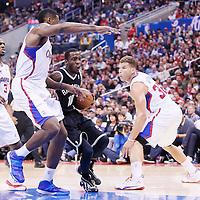 16 November 2013: Brooklyn Nets Tyshawn Taylor drives past Los Angeles Clippers center DeAndre Jordan (6), Los Angeles Clippers point guard Chris Paul (3) and Los Angeles Clippers power forward Blake Griffin (32) during the Los Angeles Clippers 110-103 victory over the Brooklyn Nets at the Staples Center, Los Angeles, California, USA.