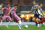 Ian Henderson shoots during the Carabao Cup match between Grimsby Town FC and Rochdale at Blundell Park, Grimsby, United Kingdom on 14 August 2018.