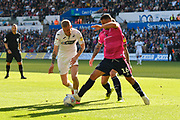 Oli McBurnie (9) of Swansea City is challenged by Tomer Hemed (16) of Queens Park Rangers during the EFL Sky Bet Championship match between Swansea City and Queens Park Rangers at the Liberty Stadium, Swansea, Wales on 29 September 2018.