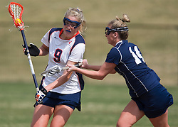 Virginia A Whitaker Hagerman (9) is checked by PSU M Mary Dean (11).  The #2 ranked Virginia Cavaliers women's lacrosse team defeated the Penn State Nittany Lions 12-11 in overtime at Klockner Stadium on the Grounds of the University of Virginia in Charlottesville, VA on March 7, 2009.