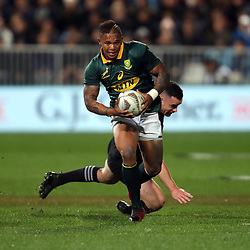 Ryan Crotty looks to tackle Elton Jantjies during the Rugby Championship match between the New Zealand All Blacks and South Africa Springboks at QBE Stadium in Albany, Auckland, New Zealand on Saturday, 16 September 2017. Photo: Shane Wenzlick / lintottphoto.co.nz