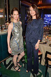 Left to right, SIENNA GUILLORY and OLGA KURYLENKO at a dinner hosted by Creme de la Mer to celebrate the launch of Genaissance de la Mer The Serum Essence held at Sexy Fish, Berkeley Square, London on 21st January 2016.