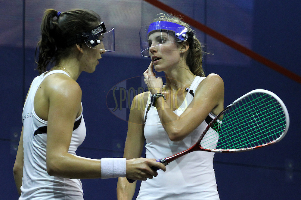 Joelle King and Jaclyn Hawkes of New Zealand during the final of the women's doubles squash competition held at the Siri Fort Complex in New Delhi as part of the XIX Commonwealth Games, India on the 13 October 2010..Photo by:  Ron Gaunt/photosport.co.nz