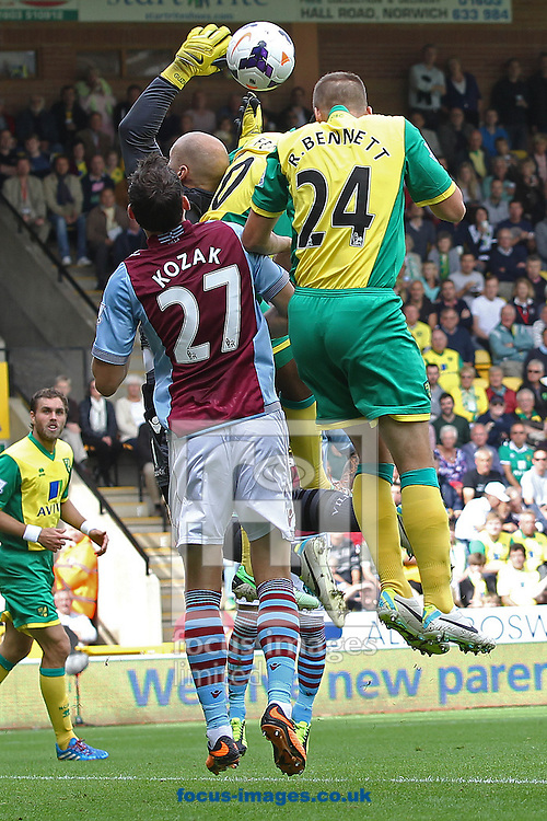 Picture by Paul Chesterton/Focus Images Ltd +44 7904 640267<br /> 21/09/2013<br /> Brad Guzan of Aston Villa collects the ball safely ahead of Leroy Fer of Norwich and Ryan Bennett of Norwich during the Barclays Premier League match at Carrow Road, Norwich.
