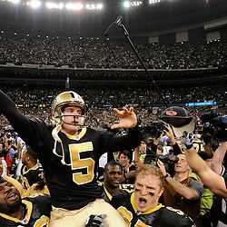 Jan 24, 2010; New Orleans, LA, USA; New Orleans Saints PK Garrett Hartley (5) rides on the shoulders on teammates after kicking a game winning field goal against the Minnesota Vikings in overtime of the 2010 NFC Championship game at the Louisiana Superdome. Mandatory Credit: Derick E. Hingle-US PRESSWIRE