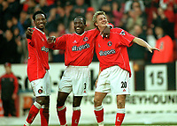 Mathias Svensson (Charlton) celebrates goal no.3 with Chris Powell (Centre) and Jason Euell (left). Charlton Athletic v Aston Villa. 22/2/2003. Credit : Colorsport/Andrew Cowie.