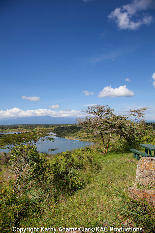 Panoramic view of Ngurdoto Crater in Arusha National Park, Tanzania.  Mount Meru is on the left and Mount Kilimanjaro is on the right in the clouds.