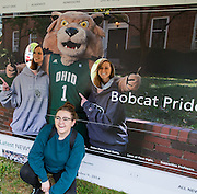 Johanna Kearns, Audrey Meredith and Danielle Fosselman pose with Rufus for the new launch event of the ohio.edu homepage on Oct. 9, 2014.