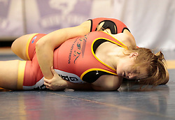 London, Ontario ---2013-03-02---  Holly Ellsworth-Clark of  the University of Calgary takes on Kelsey Gsell of  Guelph in the women's 82kg gold medal match at the 2013 CIS Wrestling Championships in London, Ontario, March 02, 2013. .GEOFF ROBINS/Mundo Sport Images