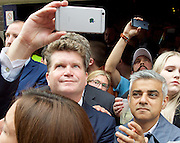 Vigil for the people murdered in the Pulse Club shooting in Orlando Florida by Omar Mateen<br /> in Old Compton Street, London, Great Britain <br /> 13th June 2016 <br /> <br /> with Sadiq Khan <br /> Mayor of London <br /> <br /> <br /> Matthew Barzun  - United States Ambassador to the United Kingdom<br /> Ambassador of the United States <br /> <br /> takes a selfie <br /> <br /> <br /> Photograph by Elliott Franks <br /> Image licensed to Elliott Franks Photography Services