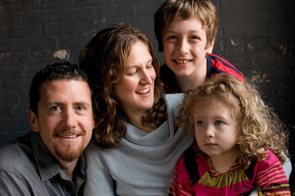 The DiPietro family sits for a family, couple and children studio portrait sitting during the annual Holiday Portrait benefit at The Brooklyn Arts Exchange in Brooklyn, New York on December 4, 2011. ..Photograph by Angela Jimenez .Angela Jimenez Photography.www.angelajimenezphotography.com
