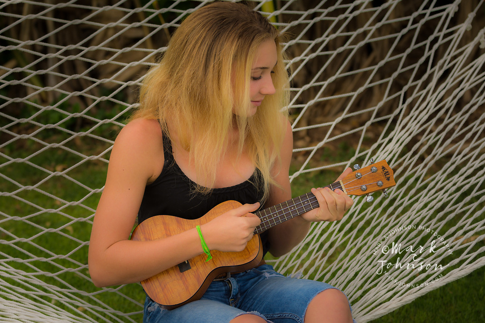 14 year old teenage girl playing the ukulele people ****Model Release available