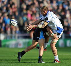 Dominic Day of Bath Rugby offloads the ball  - Photo mandatory by-line: Patrick Khachfe/JMP - Mobile: 07966 386802 18/10/2014 - SPORT - RUGBY UNION - Glasgow - Scotstoun Stadium - Glasgow Warriors v Bath Rugby - European Rugby Champions Cup