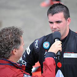 Glynn Geddie United Autosport) giving an interview in the pits after his win in the Supercar Challenge GT + Supercar event at Circuit Park Zandvoort on the 7th September 2013<br /> WAYNE NEAL | SPORTPIX.ORG.UK
