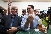 Republican presidential candidate Wisconsin Gov. Scott Walker eats an old fashioned vanilla ice cream soda while he visits with supporters at the Highland Park Soda Fountain with owner Sonny Williams in Dallas, Texas on September 2, 2015. (Cooper Neill for the Texas Tribune)