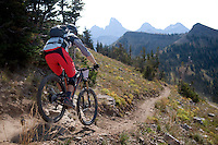 Mitch Prissel of Alta cruises along the upper section of the downhill course at Grand Targhee Resort beneath the backdrop of the Teton Range's west slope during the Wydaho Super D race.