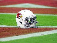 Sept. 30, 2012; Glendale, AZ, USA; Detail view of an Arizona Cardinals helmet sitting on the field at University of Phoenix Stadium. Mandatory Credit: Jennifer Stewart-US PRESSWIRE.