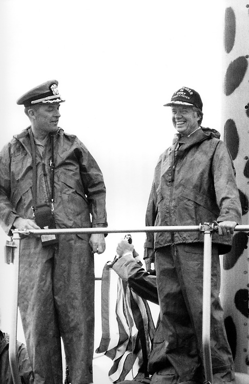 President Jimmy Carter with the commanding officer of the nuclear submarine USS Los Angeles, aboard the  sub at Port Canaveral, Florida. After boarding, the Los Angeles departed for an afternoon of sea trials. President Carter served under admiral Hyman Rickover - who accompanied him on the sea trial - during his Naval career. - To license this image, click on the shopping cart below -