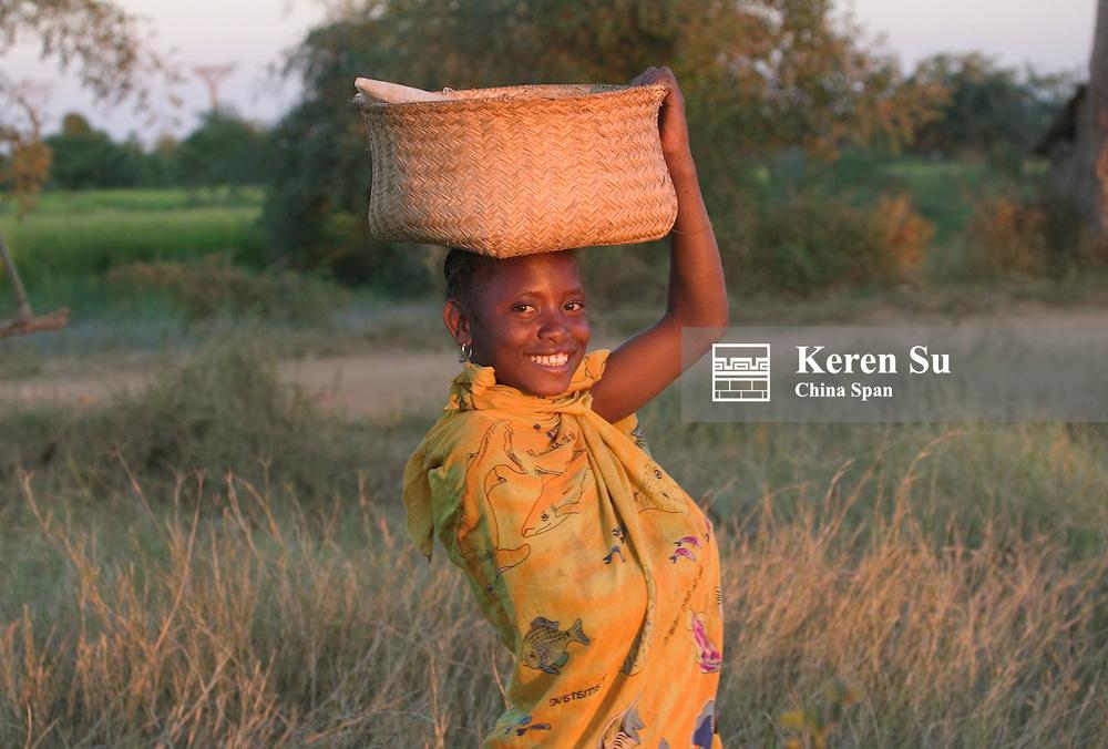 Woman carrying basket on the head, Morondava, Madagascar