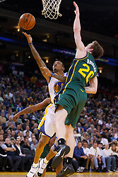 Feb 2, 2012; Oakland, CA, USA; Golden State Warriors shooting guard Monta Ellis (8) shoots past Utah Jazz shooting guard Gordon Hayward (20) during the first quarter at Oracle Arena. Mandatory Credit: Jason O. Watson-US PRESSWIRE