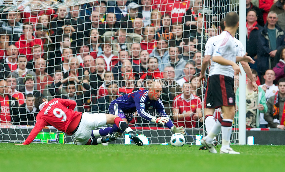 MANCHESTER, ENGLAND - Sunday, September 19, 2010: Liverpool's goalkeeper Pepe Reina and Manchester United's Dimitar Berbatov during the Premiership match at Old Trafford. (Photo by David Rawcliffe/Propaganda)