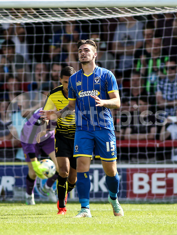 George Oakley of AFC Wimbledon rues missing an opportunity during the Pre-season Friendly match between AFC Wimbledon and Watford at the Cherry Red Records Stadium, Kingston, England on 11 July 2015. Photo by Ken Sparks.