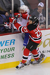 Feb 2; Newark, NJ, USA; New Jersey Devils right wing David Clarkson (23) hits Montreal Canadiens defenseman Josh Gorges (26) during the first period at the Prudential Center.