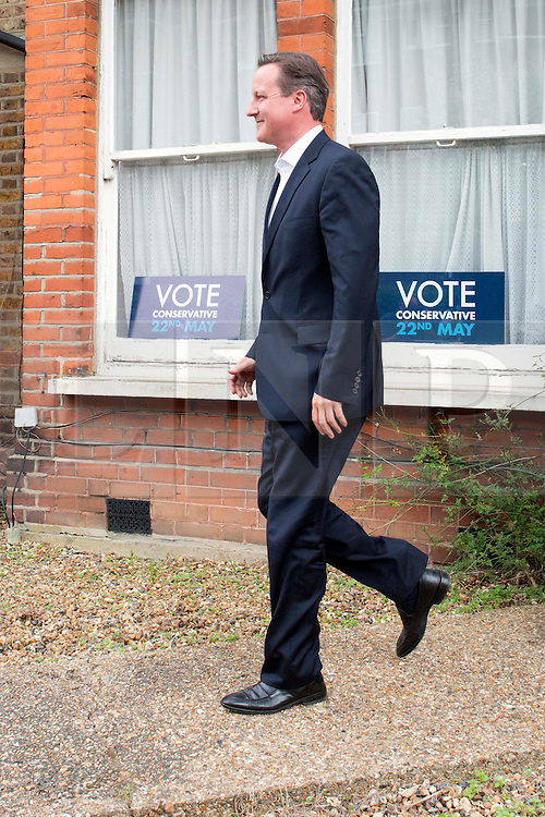 © Licensed to London News Pictures. 21/05/2014. London, UK David Cameron leaves Ealing Central and Acton Conservative Association after meeting members there on 21st May 2014. Mr Cameron is currently campaigning ahead of the European and local elections. Photo credit : Stephen Simpson/LNP
