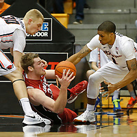 Stanford's Grant Verhoeven, center, grabs a loose ball from Oregon State's Olaf Schaftenaar, left, and Gary Payton II in the first half of an NCAA college basketball game, in Corvallis, Ore., on Wednesday, Jan. 6, 2016. AP Photo/Timothy J. Gonzalez)