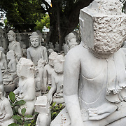 Local artisans undertake the dusty and backbreaking work of carving statues of the Buddha out of marble. With Buddhism being the dominant religion in Myanmar, there is considerable demand for the statues, with clients able to choose from a myriad of poses, sizes, and styles. The artisans are clustered on a street in the Chanmyathazi neighborhood of Mandalay near the Mahamuni Pagoda.