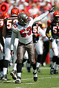 TAMPA, FL - OCTOBER 15:  Linebacker Shelton Quarles #53 of the Tampa Bay Buccaneers points in celebration after making a tackle during a key defensive stand against the Cincinnati Bengals at Raymond James Stadium on October 15, 2006 in Tampa, Florida. The Bucs defeated the Bengals 14-13. (©Paul Anthony Spinelli) *** Local Caption *** Shelton Quarles