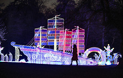 © Licensed to London News Pictures. 18/01/2017. London, UK. A woman looks up at a boat lantern on display at he Chiswick House Magic Lantern Festival. The Festival is a fusion of art, heritage and culture. Illuminating outdoor installations of beautifully sculpted lanterns taking various forms. Opening tomorrow and running until February 26th 2017 the theme for this year's festival is: 'Explore The Silk Road'. Visitors will discover life-sized and oversized lantern scenes, which represent and highlight this significant route of trade and culture from Europe to Ancient China.Photo credit: Peter Macdiarmid/LNP