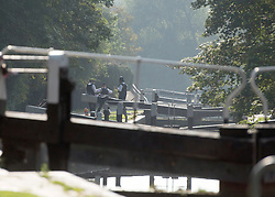 © Licensed to London News Pictures. 09/09/2014. Hanwell, UK Police continue to cordon off a section of the Grand Union Canal in Isleworth in the search for missing school girl Alice Gross today 9th September 2014.  Alice Gross of Hanwell, west London, was last seen by her family at about 13:00 BST on 28 August. CCTV footage shows her walking along the Grand Union Canal tow path near the Holiday Inn at Brentford Lock between 13:30 BST and 17:30 BST.. Photo credit : Stephen Simpson/LNP