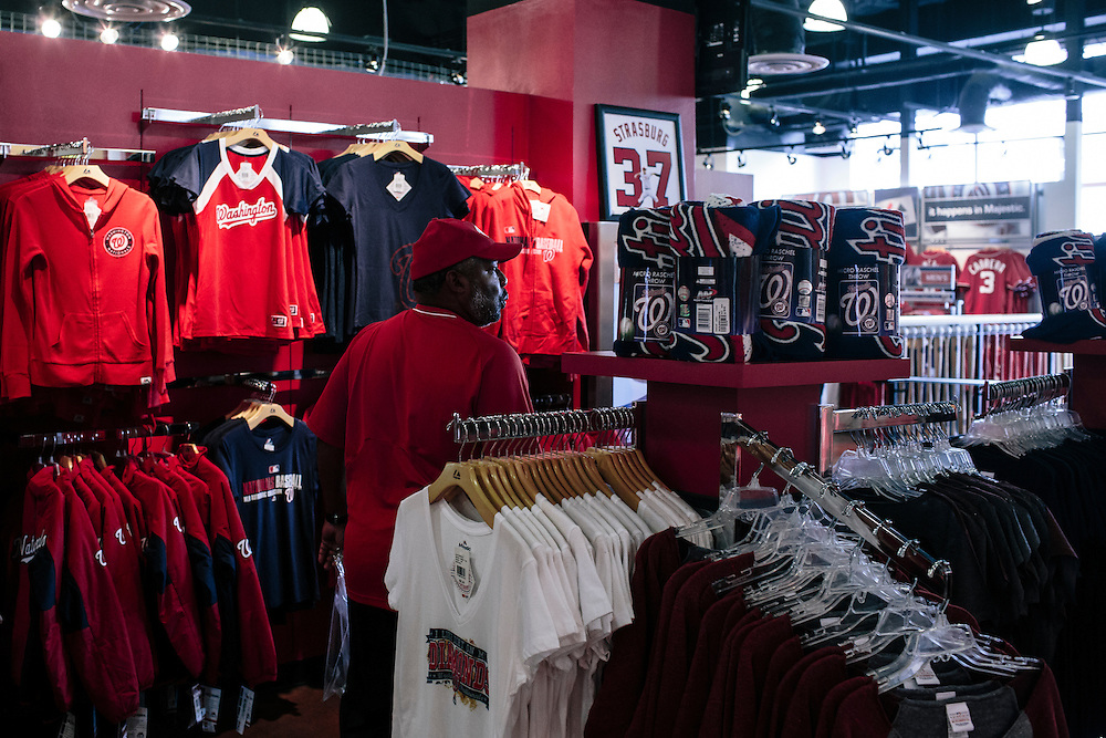 Fans check out post season shirts and hats at the Washington Nationals Clubhouse Team Store on Sept. 18, 2014. The Nationals and Baltimore Orioles clinched the first two post season spots within hours of one another.