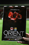 A Leyton Orient fans holds the special edition programme to commemorate to mark the 100th anniversary of the start of WWI before the Johnstone's Paint Trophy match at the Matchroom Stadium London,<br /> Picture by David Horn/Focus Images Ltd +44 7545 970036<br /> 11/11/2014