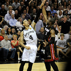 Jun 13, 2013; San Antonio, TX, USA; Miami Heat shooting guard Dwyane Wade (3) shoots against San Antonio Spurs shooting guard Danny Green (4) during the second quarter of game four of the 2013 NBA Finals at the AT&T Center. Mandatory Credit: Derick E. Hingle-USA TODAY Sports