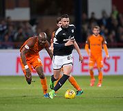 August 9th 2017, Dens Park, Dundee, Scotland; Scottish League Cup Second Round; Dundee versus Dundee United; Dundee's Marcus Haber races away from Dundee United's William Edjenguele